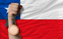 bronze medal for sport and  national flag of chile - stock photo