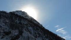 Sun rising, sun, behind the mountain, mountain, Gran Paradiso National Park Stock Footage