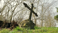 Stock Video Footage of old crucifix on abandoned graveyard
