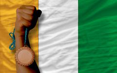 Bronze medal for sport and  national flag of cote ivore Stock Photos