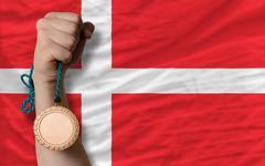 bronze medal for sport and  national flag of denmark - stock photo