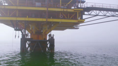 Automated gas production offshore platform in the misty sea Stock Footage