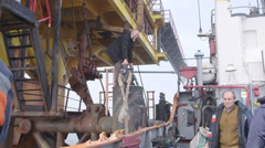 Staff members are transported at offshore gas production platform Stock Footage
