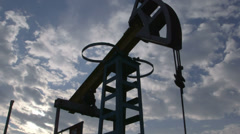 Oil well being produced by a pumpjack Stock Footage