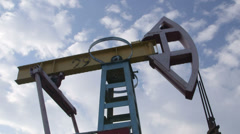 Pump jack lifting oil from well to the surface Stock Footage