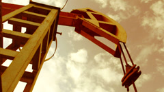 Pump jack - iconic symbol of oilfield - stock footage
