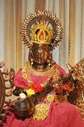 Goddess statue in temple - stock photo