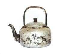 Old kettle on a white background Stock Photos