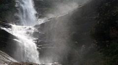 Mist rising off Moray Falls waterfall Stock Footage