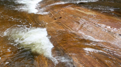 Water flowing over rocks in river Stock Footage