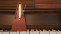 4K Metronome and Piano - stock footage