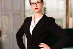 attractive brunette female business woman ceo office workplace workday - stock photo