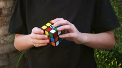 4K Teenage boy trying to solve a Rubik's Cube Stock Footage