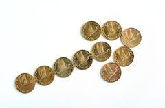 Nz dollar coins with upward trend arrow Stock Photos