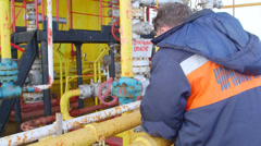 Engineer working on offshore gas and oil production platform Stock Footage