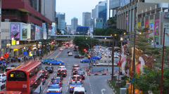 Singapore Chinatown busy bustle traffic at dusk Stock Footage