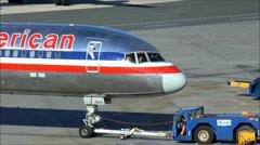 Airplane tow tug on tarmac - stock footage