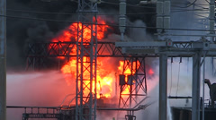 Electrical power grid explosion and fire at transformer station Stock Footage