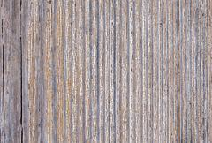 Stock Photo of old worn plank wall with upright white paint