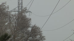 Power lines swaying in ice storm Stock Footage