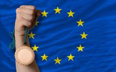 bronze medal for sport and  national flag of europe - stock photo