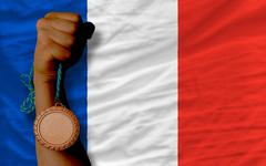 bronze medal for sport and  national flag of france - stock photo