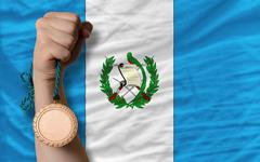 bronze medal for sport and  national flag of guatemala - stock photo