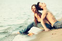 couple at the beach - stock photo