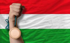 Stock Photo of bronze medal for sport and  national flag of hungary