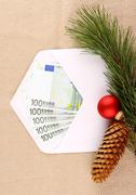 christmas bonus, five hundred euro in envelope and decor - stock photo