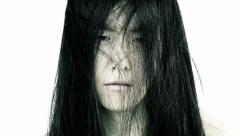 Sad depressed asian woman with messy hair Stock Footage
