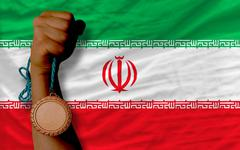 Stock Photo of bronze medal for sport and  national flag of iran