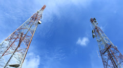 Two telecommunications mast - stock footage