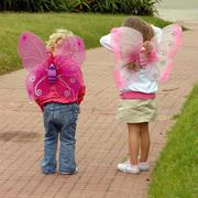 two small girls wearing butterfly costume wings - stock photo