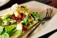 closeup of caesar salad - stock photo