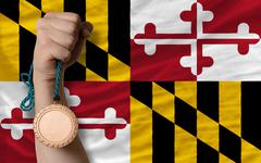 Stock Photo of bronze medal for sport and  flag of american state of maryland