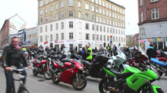 Bicycles passing motorcycles Stock Footage