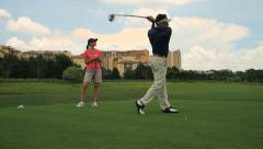 golfer drives ball off tee - stock footage