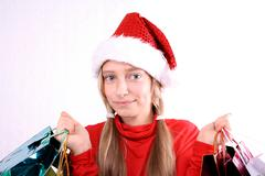 contented girl as mrs. santa with shopping bags - stock photo