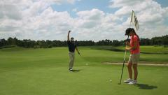 Stock Video Footage of golfer putting on green miss