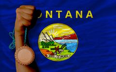 Stock Photo of bronze medal for sport and  flag of american state of montana