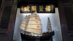 Singapore Miniature of early days of Chinese fishing boat junk in Chinatown - stock footage