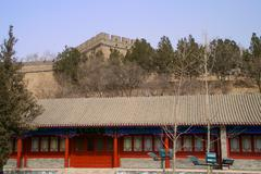 A traditional chinese building outside the great wall of china - stock photo