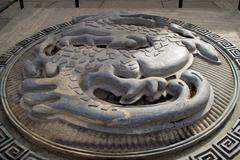 Stock Photo of Stone Dragon Emblem Outside The Great Wall of China