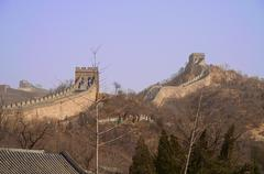 The Great Wall of China with barren trees in the foreground Stock Photos
