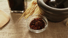 Sichouan pepper in small glass bowl and in mortar; Stock Footage