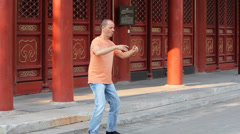 Man practices Qi Gong,a system of deep breathing exercises in Jingshan park Stock Footage