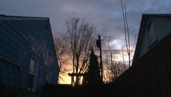 Between Two Houses Sunrise or Sunset Timelapse Stock Footage