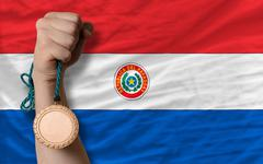 bronze medal for sport and  national flag of paraguay - stock photo