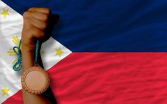 Stock Photo of bronze medal for sport and  national flag of philippines
